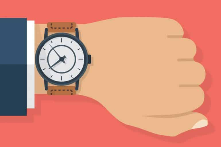 Auf die Uhr schauen, um pünktlich zu sein und nicht zu spät zur Arbeit zu kommen